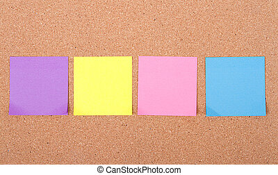 assorted blank sticky notes on a bulletin board