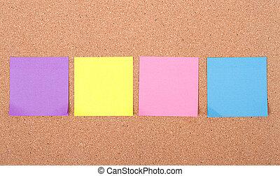 sticky notes on a bulletin board - assorted blank sticky ...