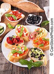 assorted bruschetta with ingredients