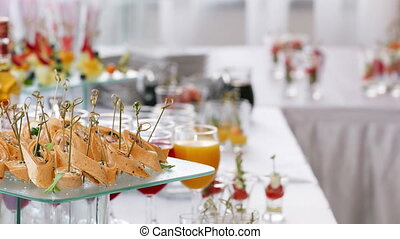 Assorted canape with cheese, meat, rolls, tortilla and fruit salad. Food to accompany the drinks. the buffet at the Banquet. A reason to celebrate the event. Wedding or anniversary