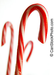 Assorted candy canes on white background