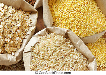 Close-up of assorted cereals in paper bags.