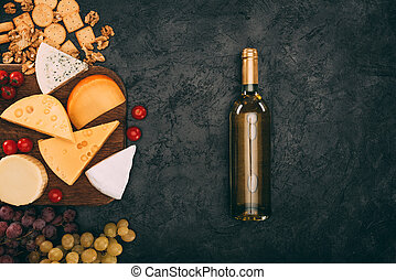 assorted cheese and bottle of wine