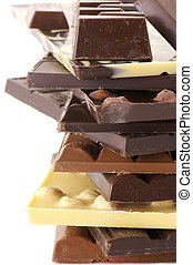 Stack of assorted chocolate close-up.