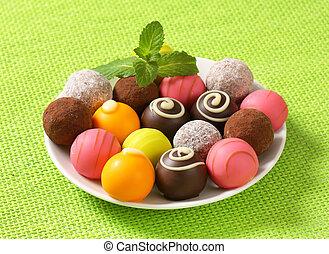 Assorted chocolate truffles and fruit ganache pralines