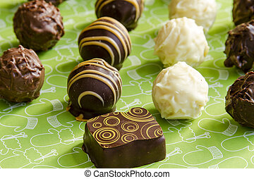 Assorted Chocolate Truffles on Table - Rows of assorted...