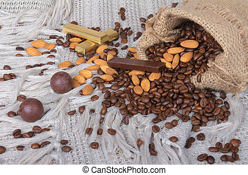 assorted chocolates, Coffee beans and almonds in canvas sack