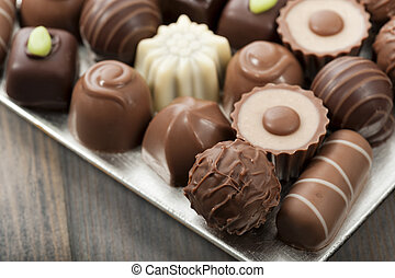 chocolates - assorted chocolates confectionery on silver...