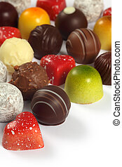 Assorted chocolates on white
