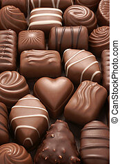 Assorted chocolates selective focus on centre heart