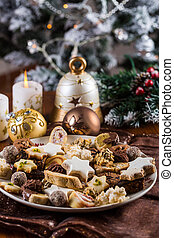 Assorted Christmas cookies with candles on the table