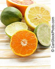 Assorted citrus - lemon, manadarin, orange and lime on a ...