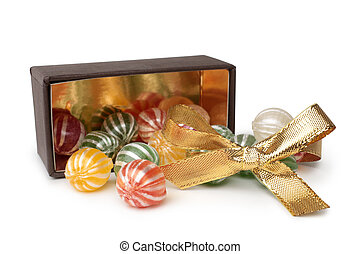 Assorted colored candies with golden decoration