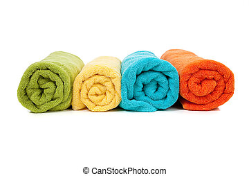Assorted colored towels on white