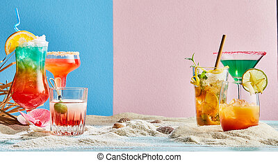 Assorted colorful alcoholic tropical cocktails