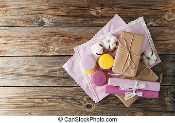 Assorted colorful french macarons and vintage gift box