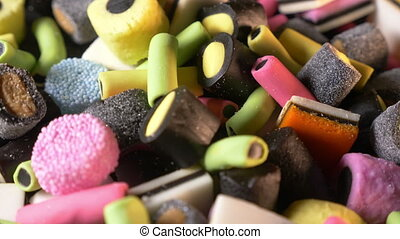 Assorted colorful juicy gummy candies, close up