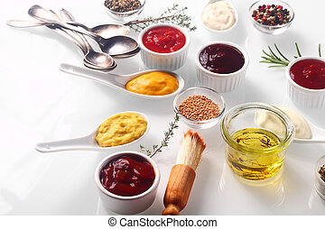 Assorted Condiments on White Wooden Table