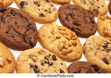 Assorted cookies on white background