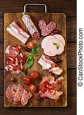 Assorted deli meats - ham, sausage, salami, parma, ...