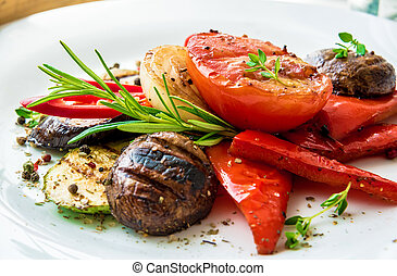 Assorted delicious grilled meat with vegetable and herbs on rustic table