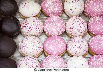 Assorted different Delicious donuts in a box