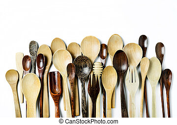 Assorted different kitchen wooden utensils cutlery on a white background