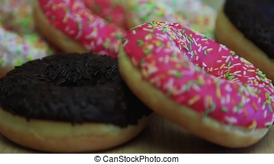 Assorted donuts are on the table. Close-up