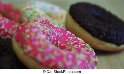 Assorted donuts are on the table. Close-up. HD
