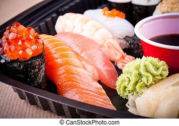 Assorted fish sushi with salmon caviar ikura, closeup