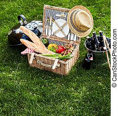Assorted food sitting inside picnic basket