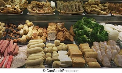 Assorted Foods at a Buffet Restaurant in Singapore - Variety...