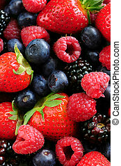 Assorted fresh berries - Background of assorted fresh ...