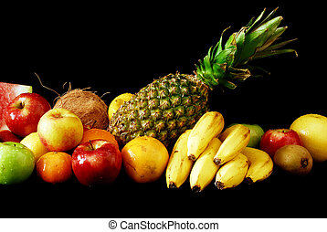 Assorted fresh fruit arranged in line