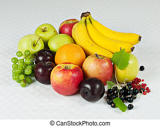 Assorted fresh fruit on table cloth