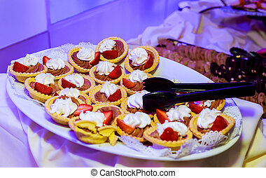 Assorted fresh fruit with custard in glasses
