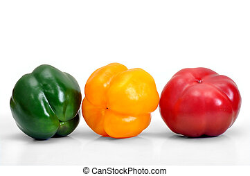 assorted fresh multicolored peppers on white background