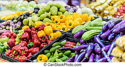 Assorted fresh vegetables put up for sale in supermarket.