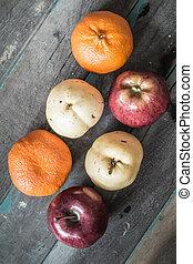 Assorted fruit on wood.