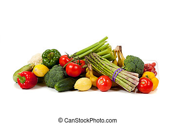 Assorted fruits and vegetables on a white background -...