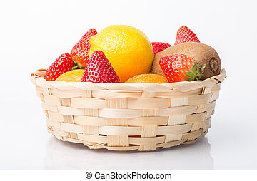 Assorted fruits in wicker basket isolated on white