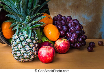 Assorted fruits placed on a wooden