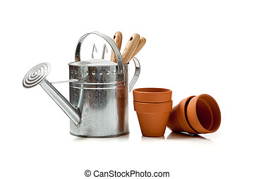 Assorted gardening supplies on a white background