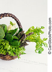 Assorted green vegetables in a basket