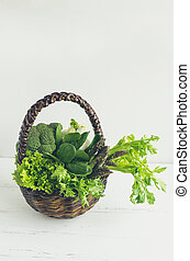 Assorted green vegetables in a basket