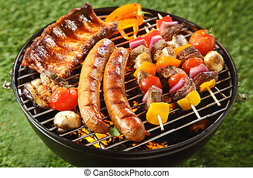 Assorted grilled meat on a summer barbecue