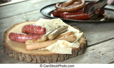 Assorted grilled sausages, pita bread. Food close up.
