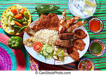 assorted grilled seafood in Mexico tequila chili hot sauces
