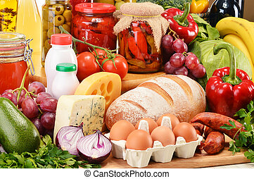 Assorted grocery products including vegetables fruits wine...