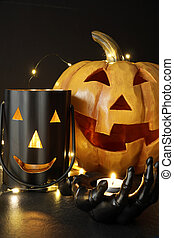 Assorted Halloween candles with pumpkin in background